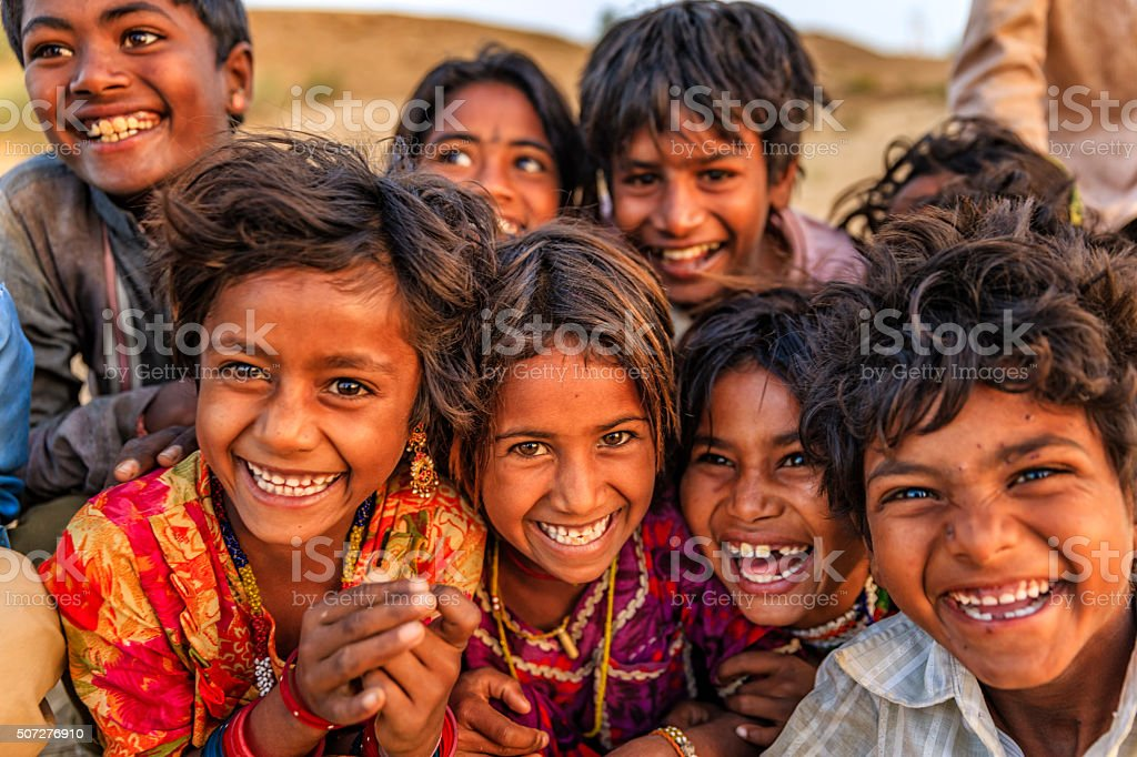 Group of happy Gypsy Indian children, desert village, India stock photo