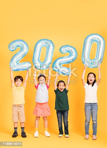 865399512istockphoto Group of happy kids celebrating and showing 2020 new year concepts 1188614574