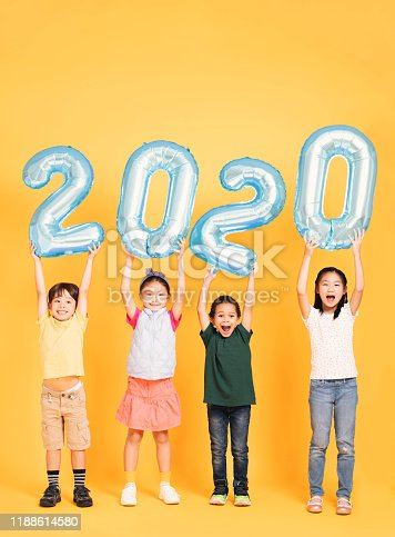 Group of happy kids celebrating and showing 2020 new year concepts