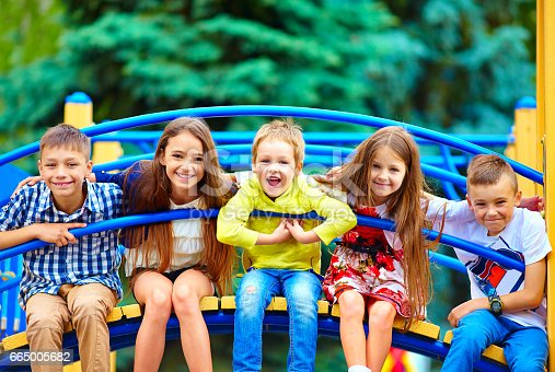istock group of happy kids having fun on playground 665005682