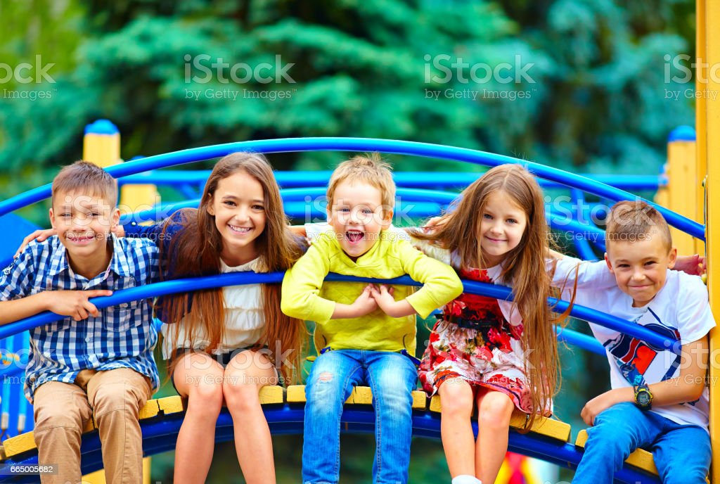 group of happy kids having fun on playground stock photo