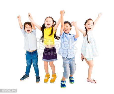 istock Group of happy  kids jumping and dancing 825502340