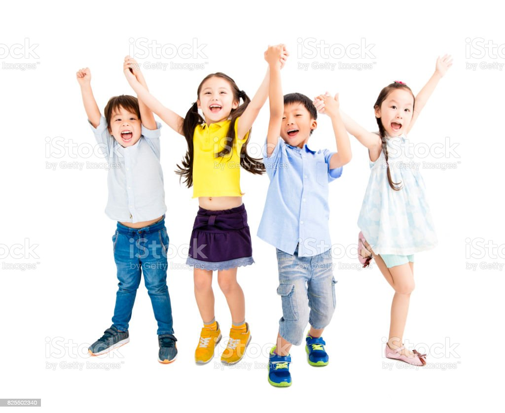 Group of happy  kids jumping and dancing stock photo