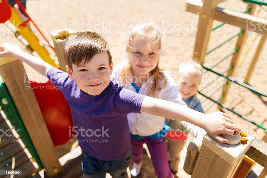 group of happy kids on children playground stock photo