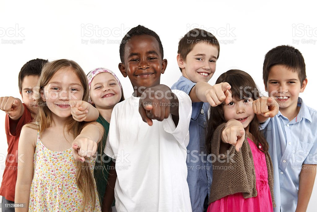 Group of happy multi ethnic children pointing on you stock photo