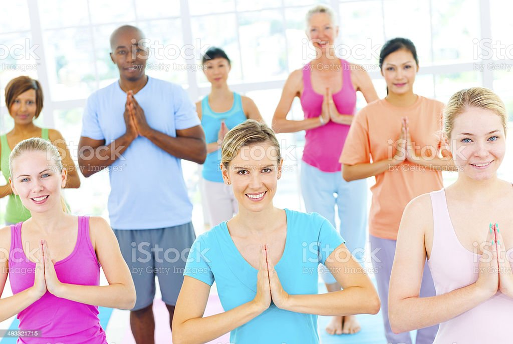 Group Of Happy Multiethnic People In A Yoga Class stock photo