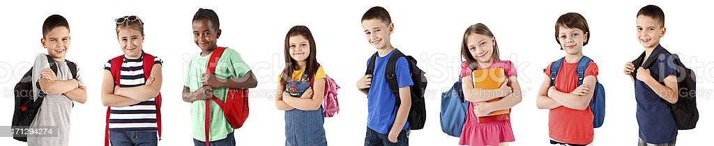 Group of happy multi-ethnic school children with backpacks stock photo