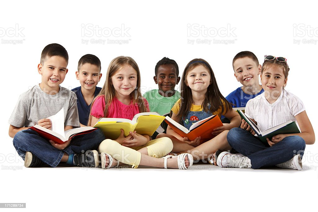 Group of happy multiracial school children reading books stock photo