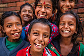 Group of happy Nepalese children in Bhaktapur, Kathmandu Valley. Bhaktapur is an ancient Newar town in the east corner of the Kathmandu Valley, Nepal. It is the third largest city in Kathmandu valley and was once the capital of Nepal during the great Malla Kingdom until the second half of the 15th century. Bhaktapur is listed as a World Heritage by UNESCO for its rich culture, temples, and wood, metal and stone artwork.