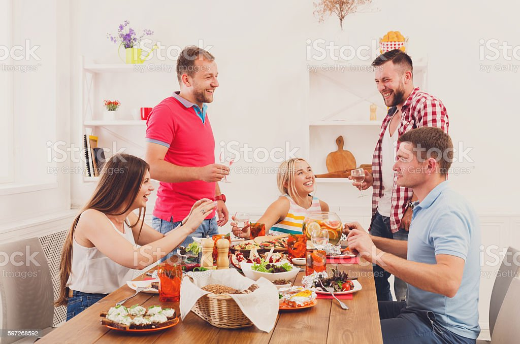 Group of happy people at festive table dinner party royalty-free stock photo