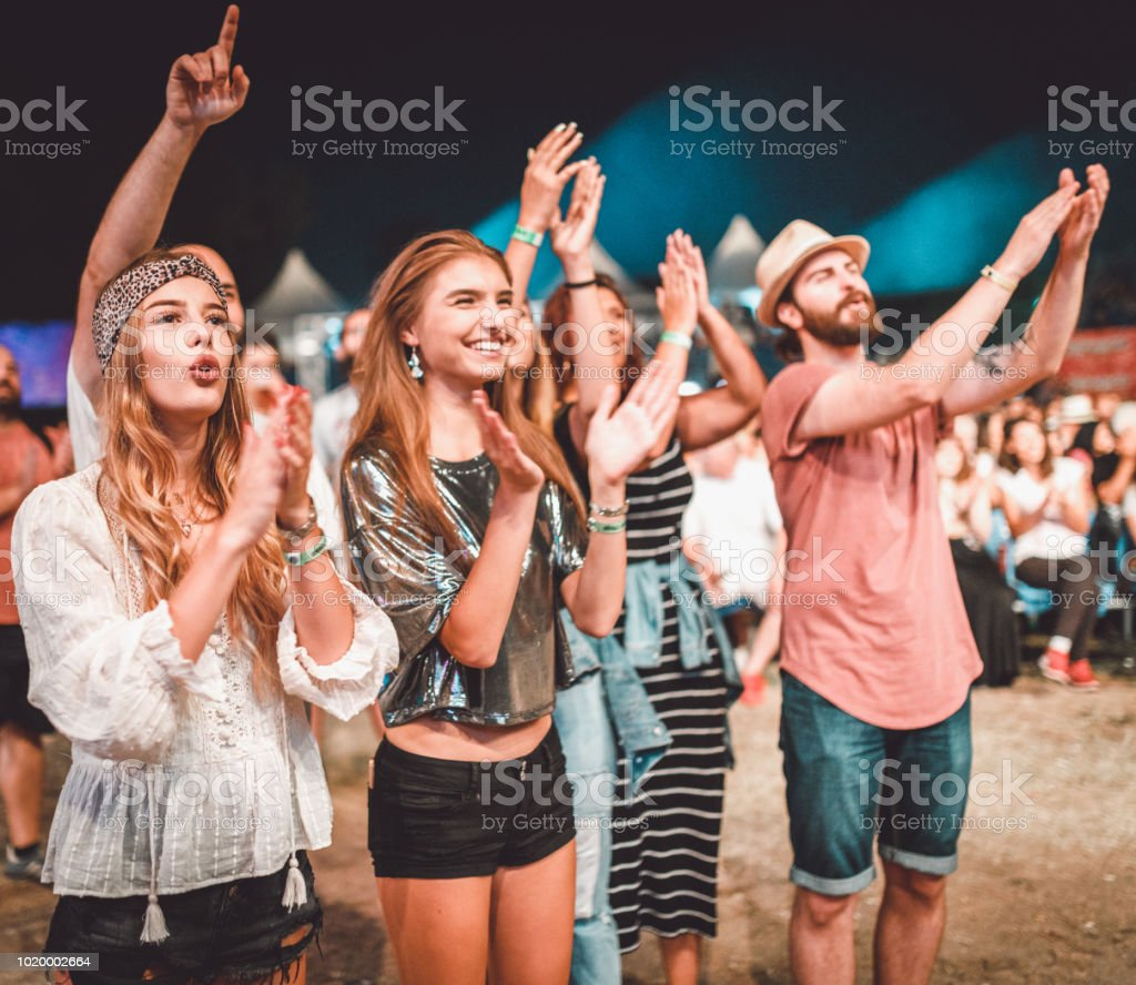 Group of happy people at the outdoors summer music festival