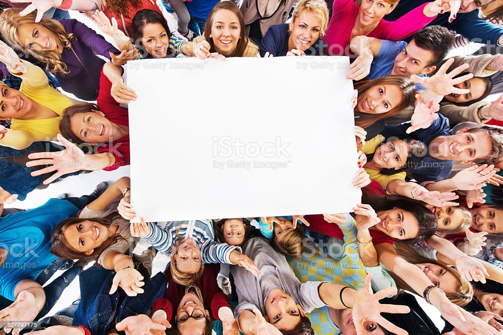 Group of happy people holding white paper. stock photo