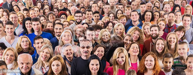 Large group of happy people looking at the camera. Isolated on white.
