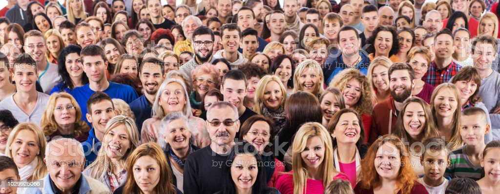 Group of happy people looking at camera. stock photo