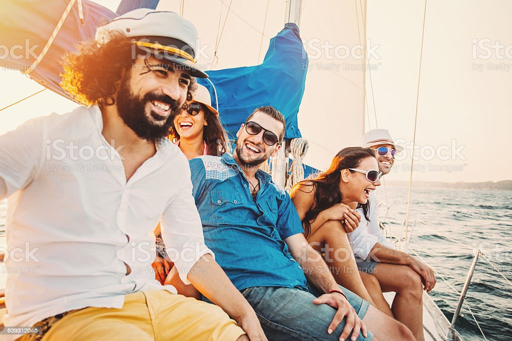 Group of happy people sailing in the summer stock photo