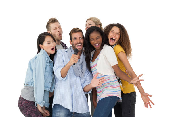 group of happy people singing into microphone - singing stock photos and pictures