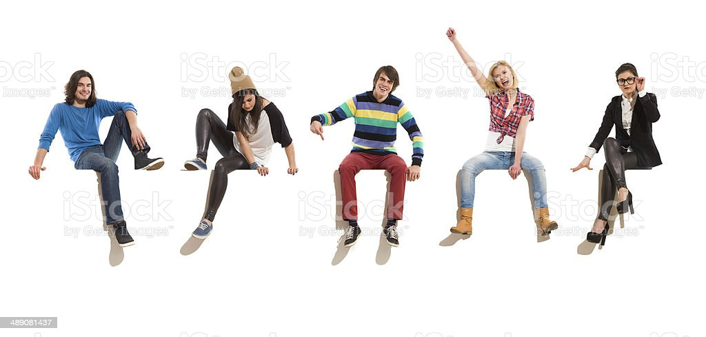 Group of happy people sitting on a big banner stock photo