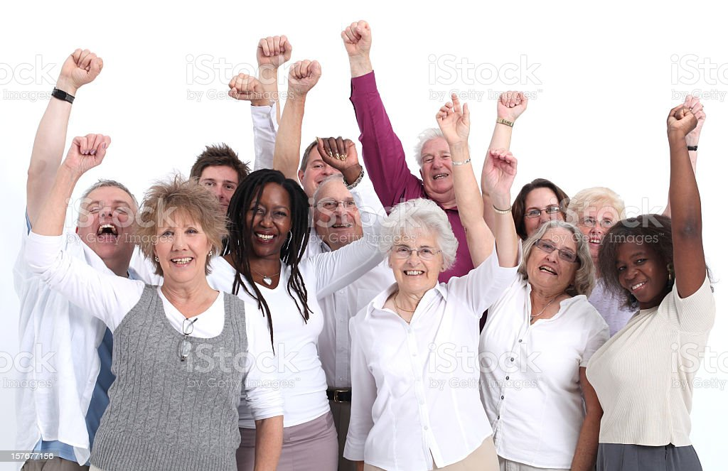 Group of happy people with their arms in the air cheering royalty-free stock photo