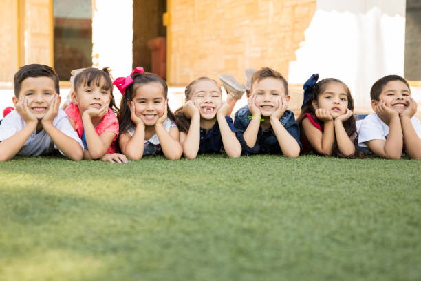 group of happy preschool students - elementary age stock photos and pictures