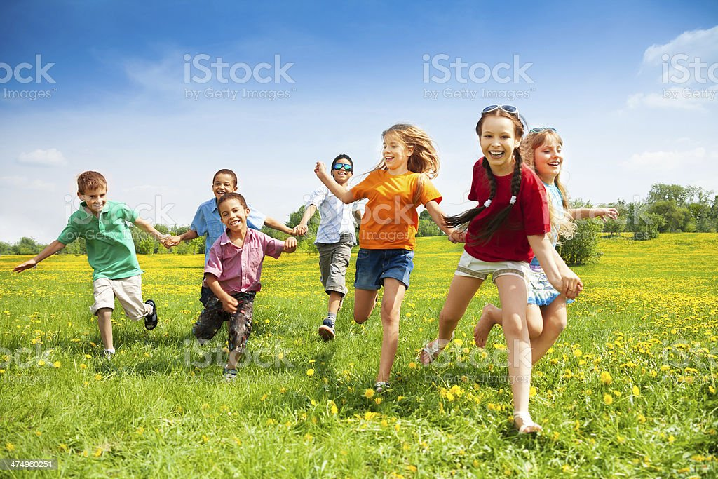 Group of happy running kids stock photo
