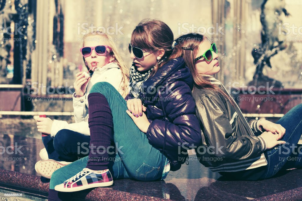 Group of happy teen girls on city street stock photo