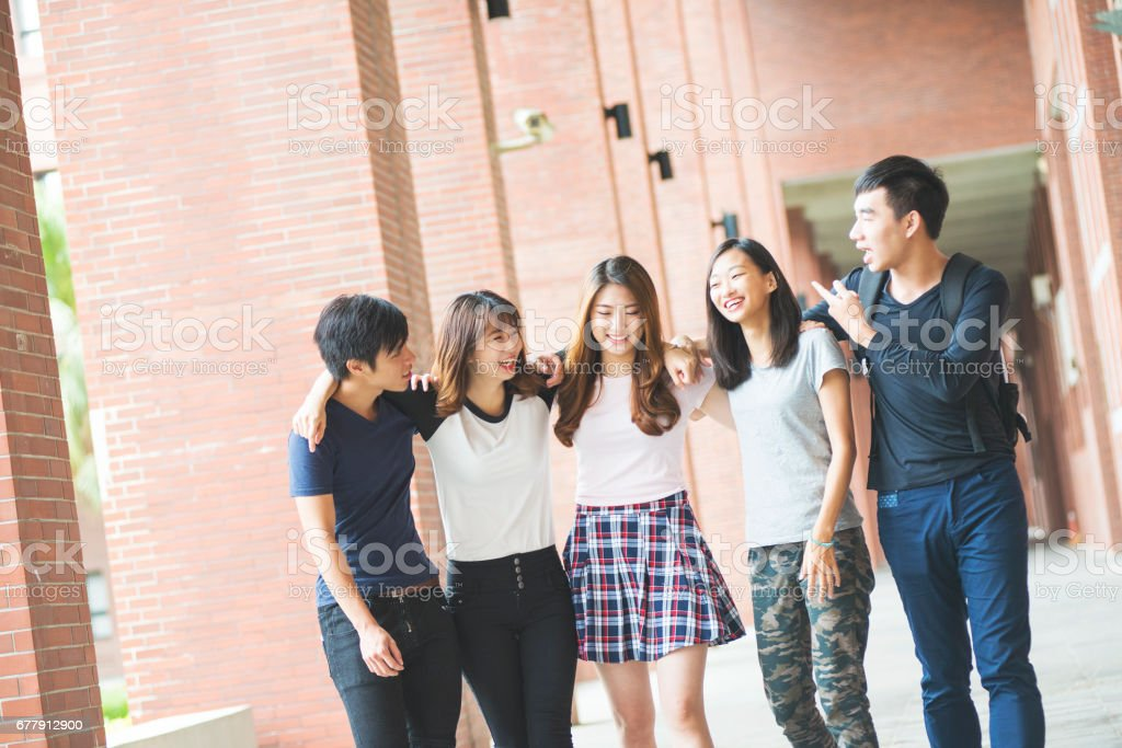 group of happy teen high school students outdoors royalty-free stock photo