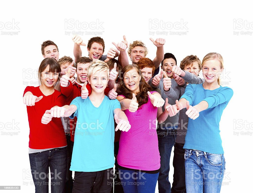 Group of happy teenagers with thumbs up sign against white royalty-free stock photo