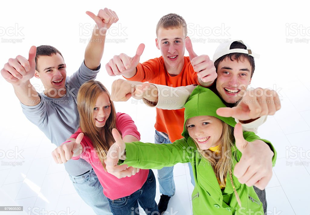 Group of happy teens showing ok with fingers. royalty-free stock photo