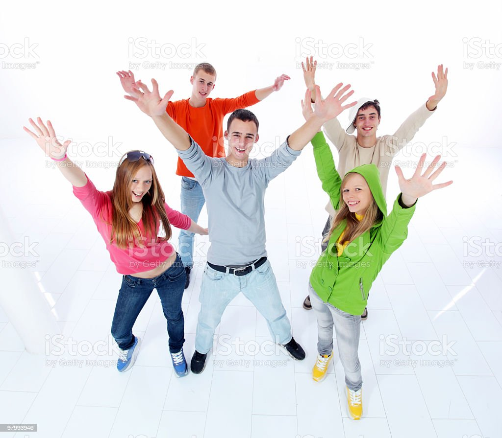 Group of happy teens with raised arms. royalty-free stock photo