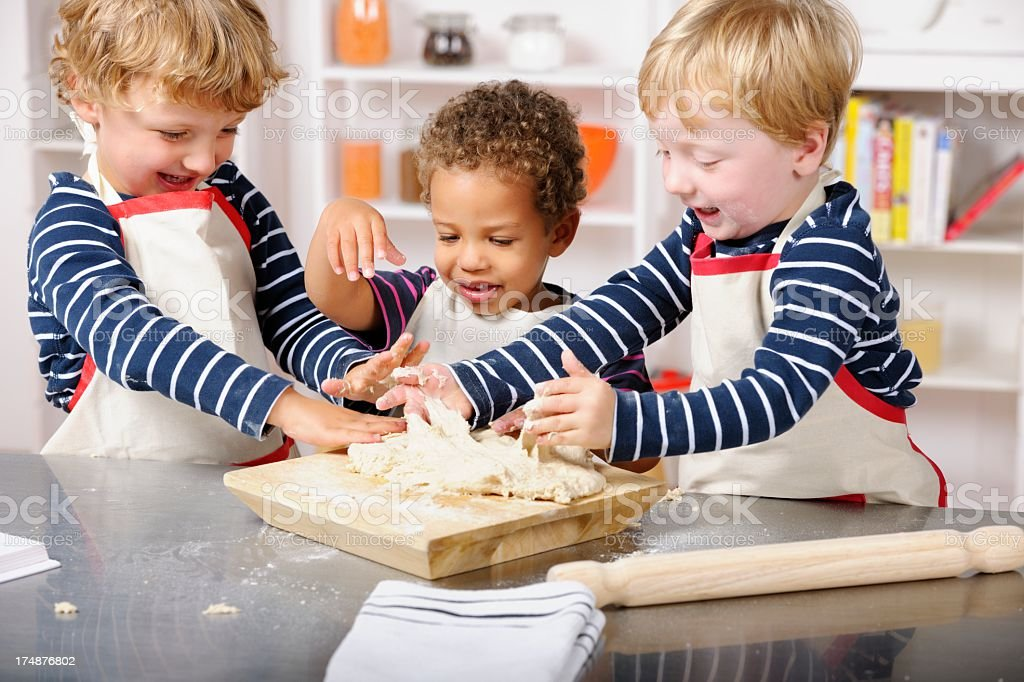 Group Of Happy Toddlers Playing With Dough royalty-free stock photo