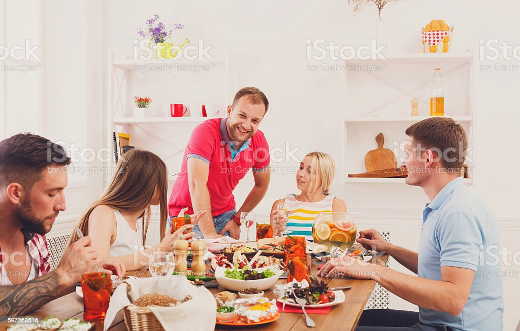 Group of happy young people at dinner table, friends party Lizenzfreies stock-foto