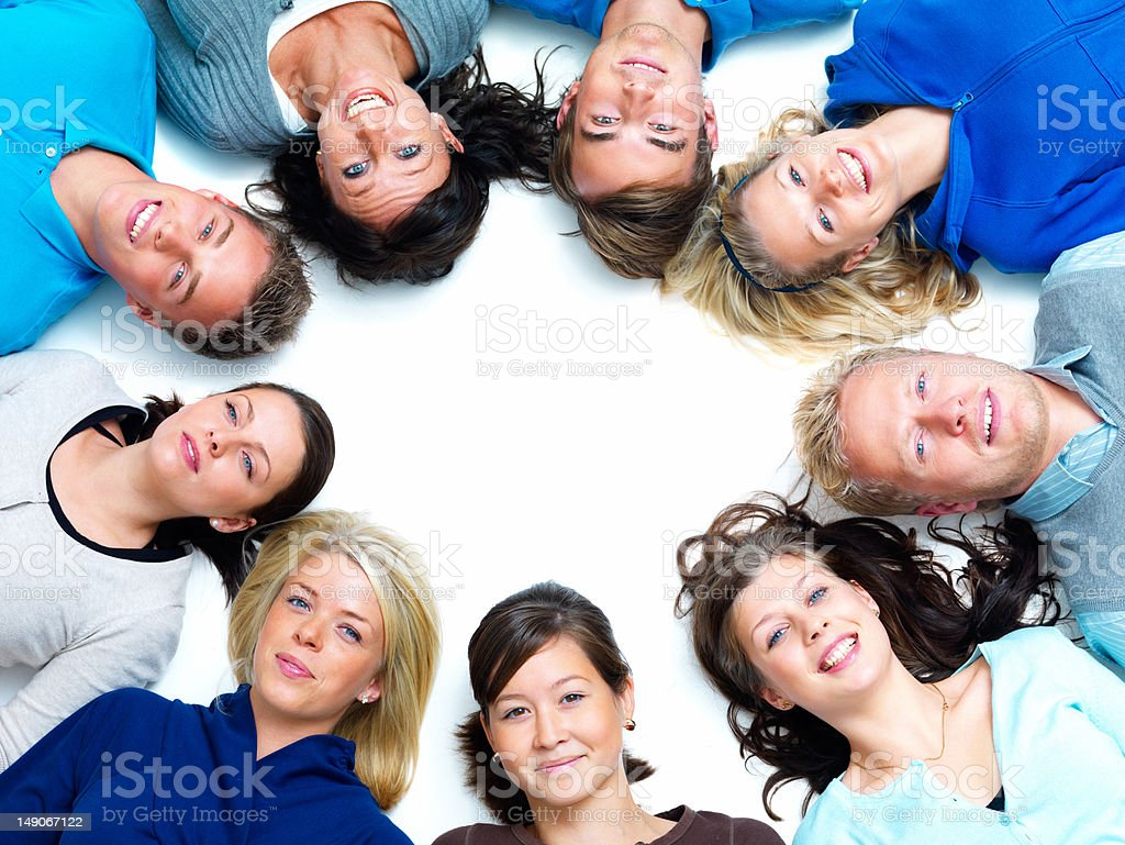 Group of happy young people lying on white royalty-free stock photo