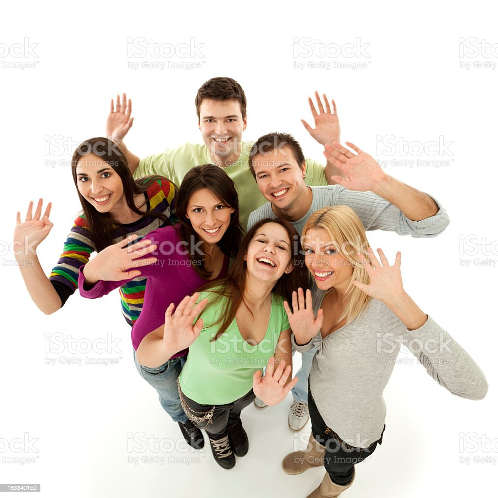 Group of happy young people waving standing on white background royalty-free stock photo