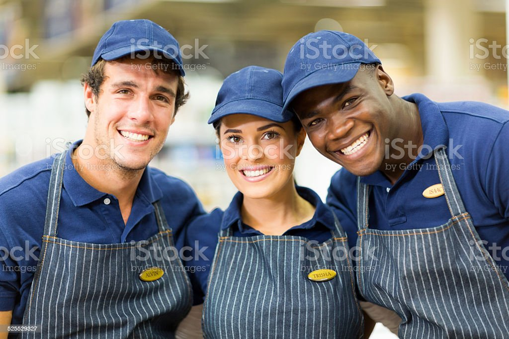 group of hardware shop workers stock photo