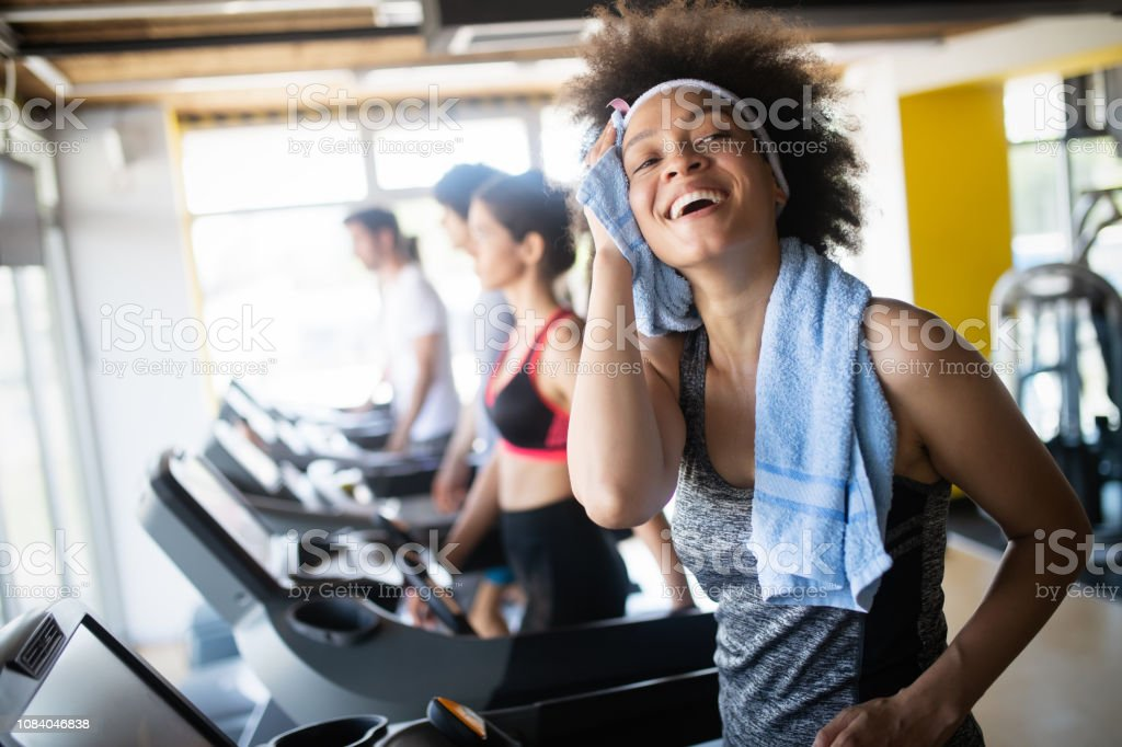 Group of healthy fit people at the gym exercising stock photo
