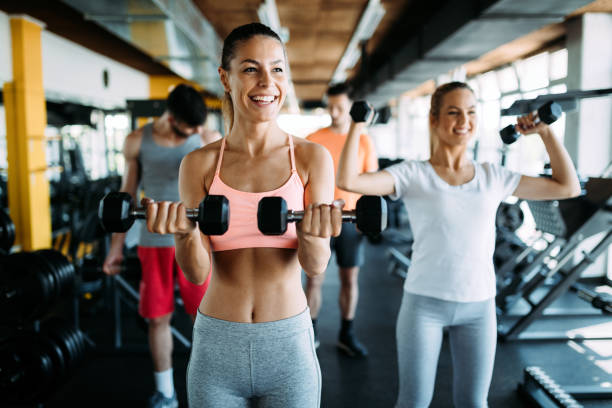 Group of healthy fitness people in gym stock photo