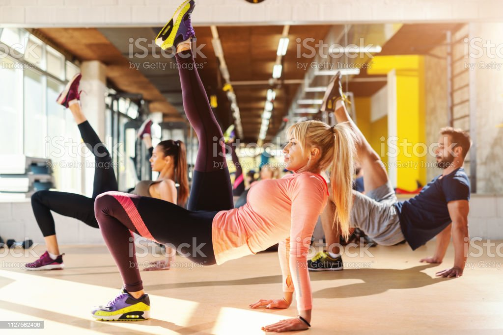 Group of healthy sporty small group of people in sportswear doing...