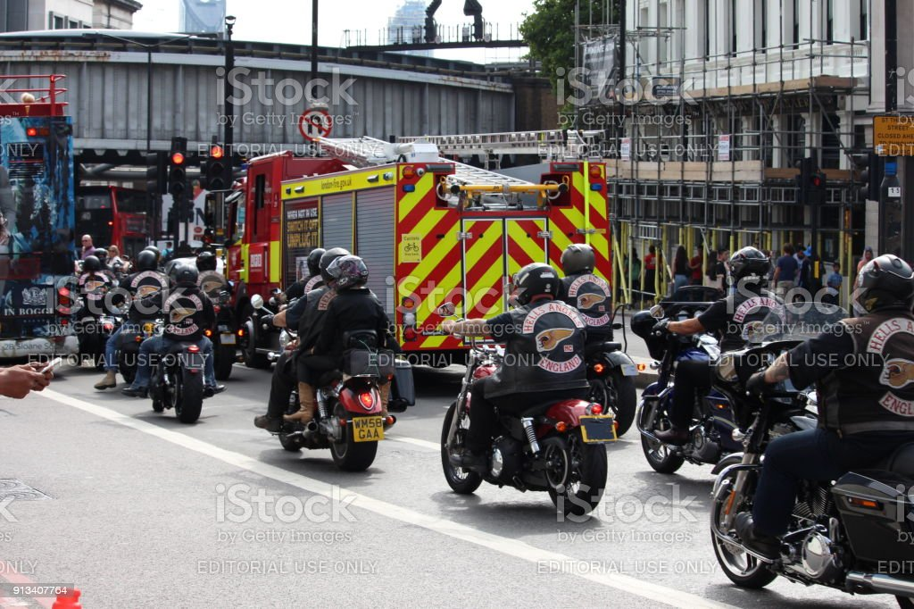 A Group Of Hells Angels Motor Bikers Stationary In A Busy