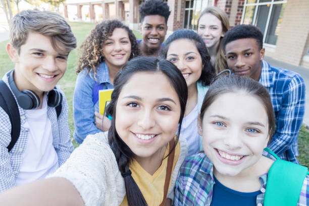 Group of high school friends take selfie together stock photo