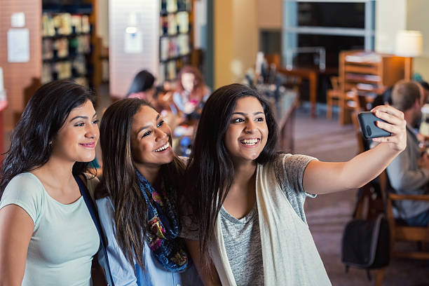 group of high school girls taking selfie photo together - arabic girl stock photos and pictures