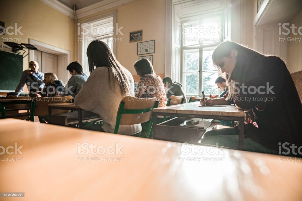 Group of high school students having a test in the classroom. royalty-free stock photo