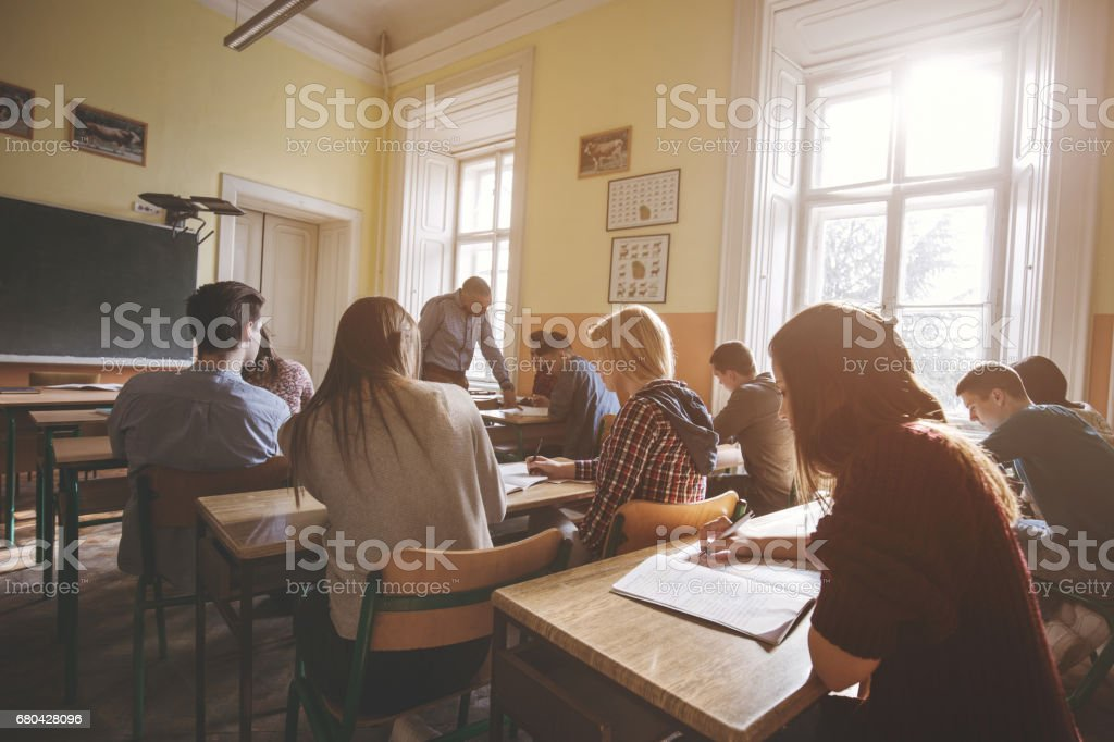 Group of high school students learning in the classroom. stock photo