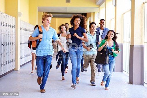istock Group Of High School Students Running In Corridor 499128157