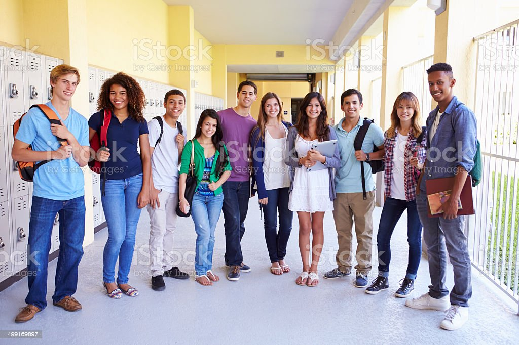 Group Of High School Students Standing In Corridor stock photo