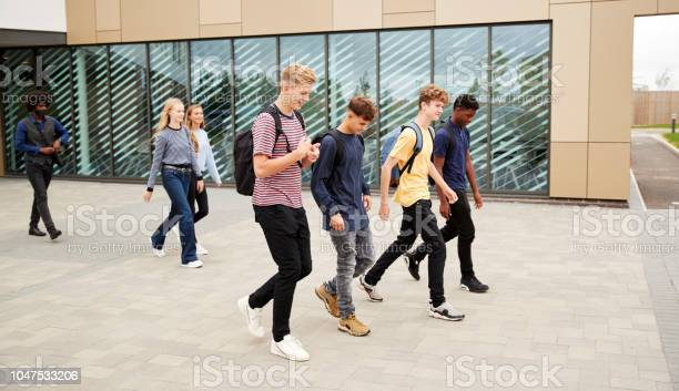 Group of high school students walking out of college building picture id1047533206?b=1&k=6&m=1047533206&s=612x612&h=qg4pgrsd2snumpmfd dscc3plg3yadhocbue8 kezji=
