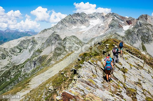 istock Group of hiker on top of the  mountain trail 610224118