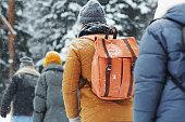 istock Group of hikers walking in line 1057945618
