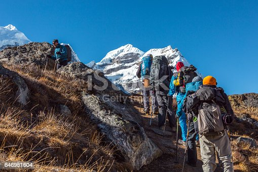 istock Group of Hikers walking up on steep Mountain Trail 646951604
