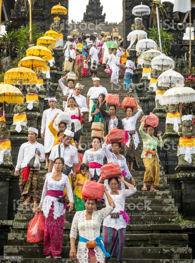A Group Of Hindu Balinese People Decend The Stairs Of