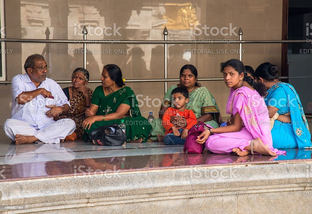 Group of Hindus sitting on a floor stock photo